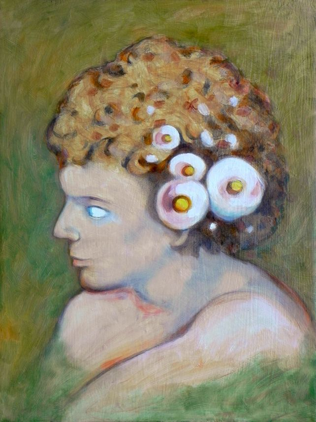 boy with flowers in the hair