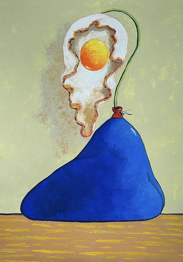 Egg flower in blue vase