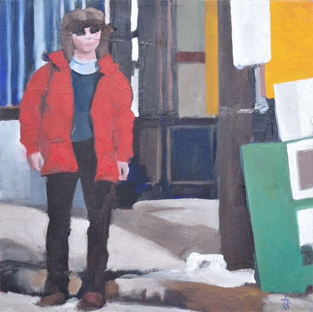 Figure with red jacket near green news box