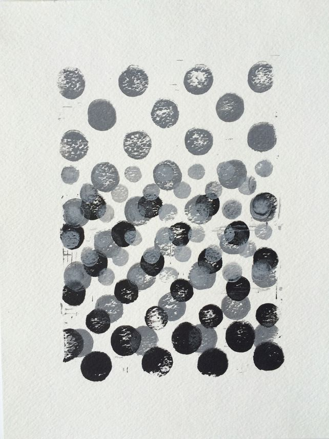 Black and Grey and White gradient dots